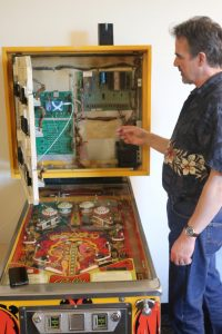 Prof. Paul Schimpf reveals CPU of EWU retro pinball machine