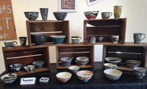 assorted mugs, vases, and bowls