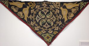 small triangle piece of tapestry