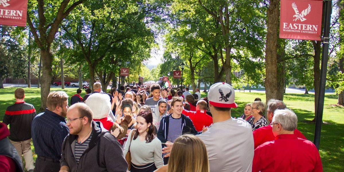 students walking through the pillars