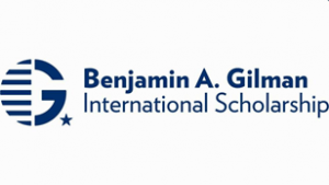 Capital G with lines covering the left half of the G next to, blue text on white background: Benjamin A. Gilman International Scholarship