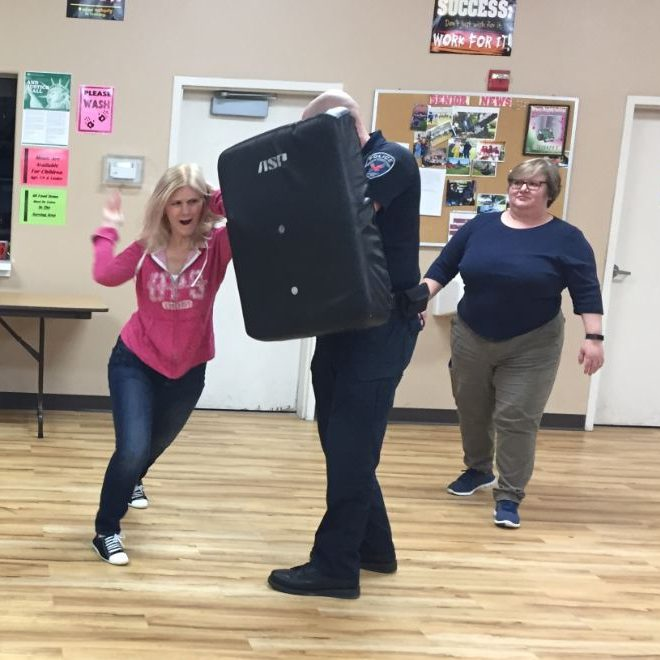 Officer Karlis instructing a self defense training.