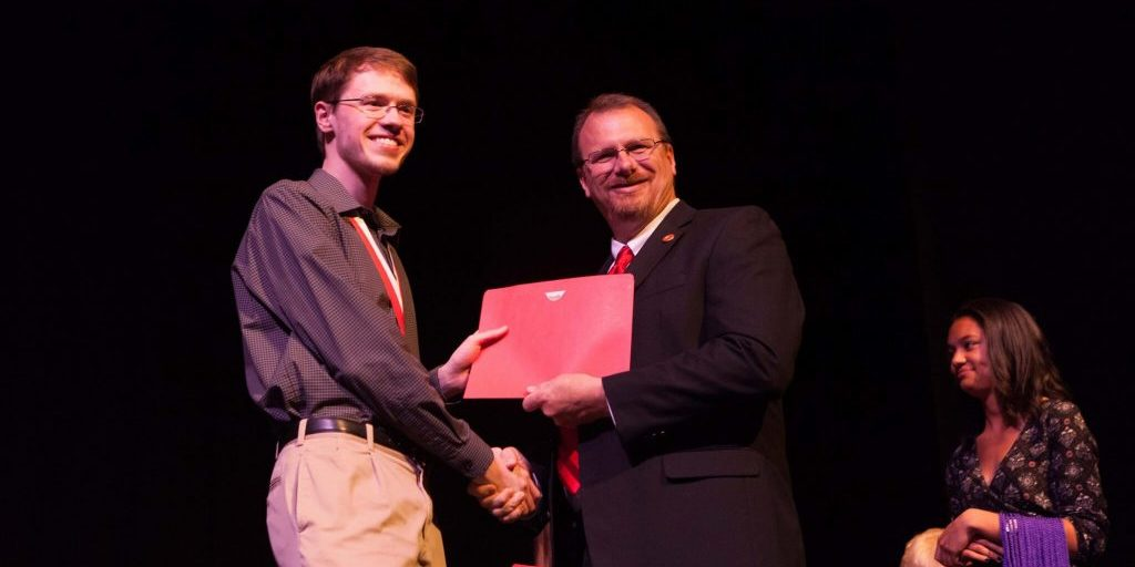 Two men shaking hands at the Honors Convocation