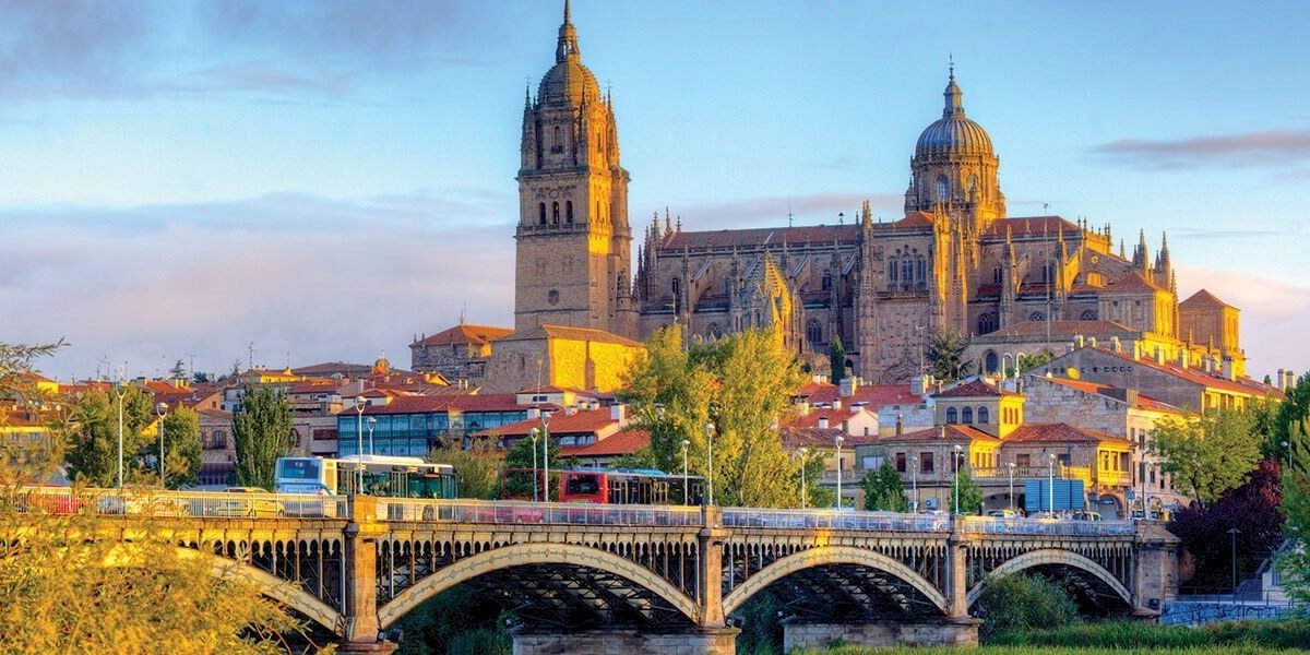 Ornate building and bridge in Salamanca, Spain